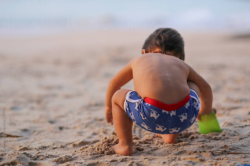 Young boy playing on the beach by Soren Egeberg for Stocksy United