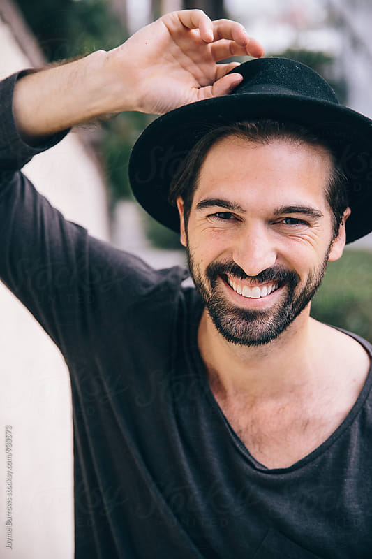 Portrait of a Hip Young Bearded Man in a Hat by Jayme Burrows for Stocksy United