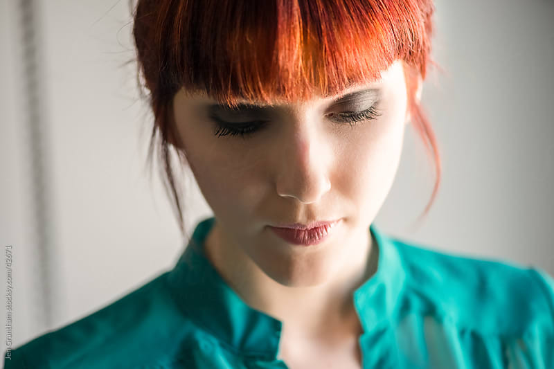 Close up of young woman with red hair by Jen Grantham for Stocksy United