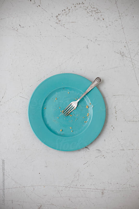 Empty dish after a meal by Lydia Cazorla for Stocksy United