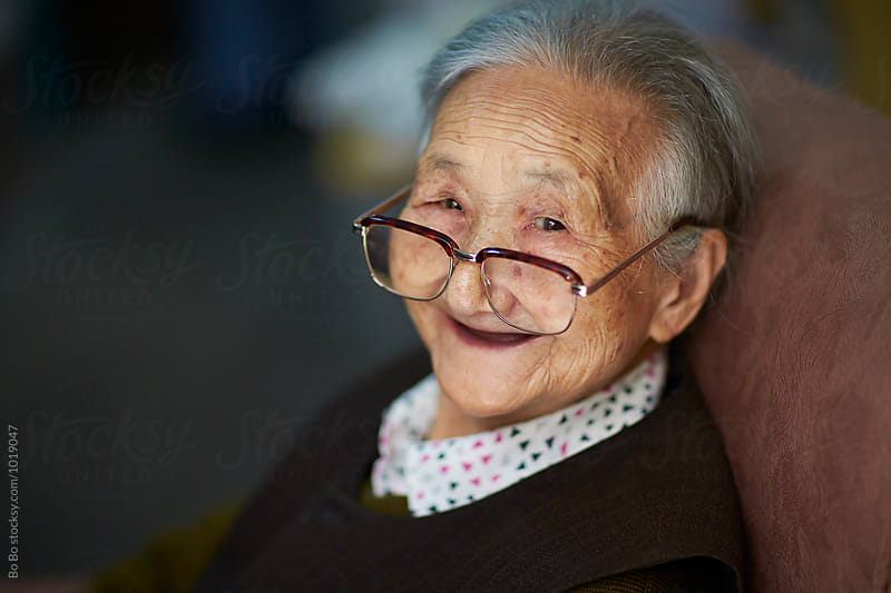 portrait of happy senior asian woman by Bo Bo for Stocksy United