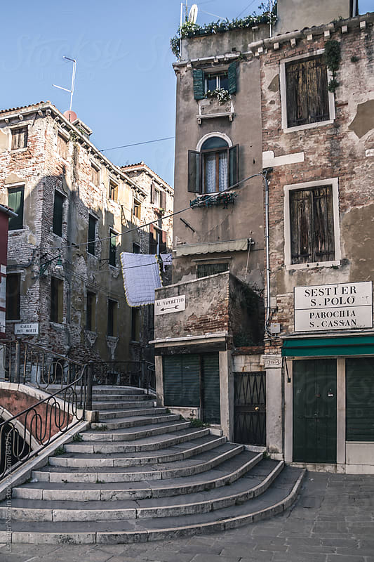 streets and alleys with traditonal buildings in venice by Leander Nardin for Stocksy United