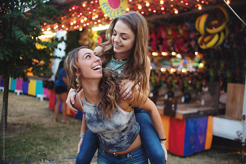 Sisters at a carnival by Chelsea Victoria for Stocksy United