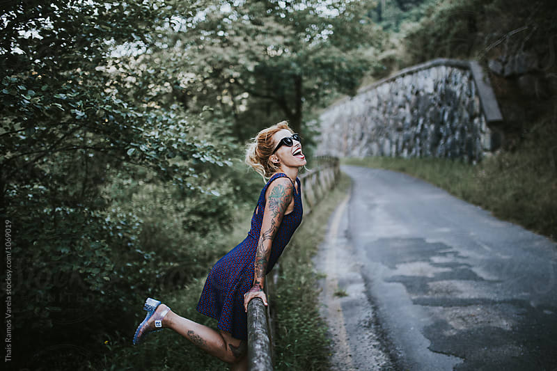 woman having fun in the mountain by Thais Ramos Varela for Stocksy United