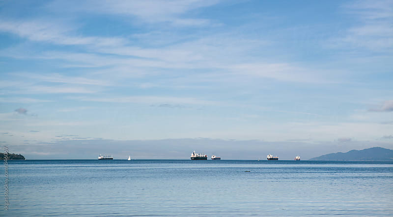 Oil tankers leaving English Bay, Vancouver, Canada by kkgas for Stocksy United