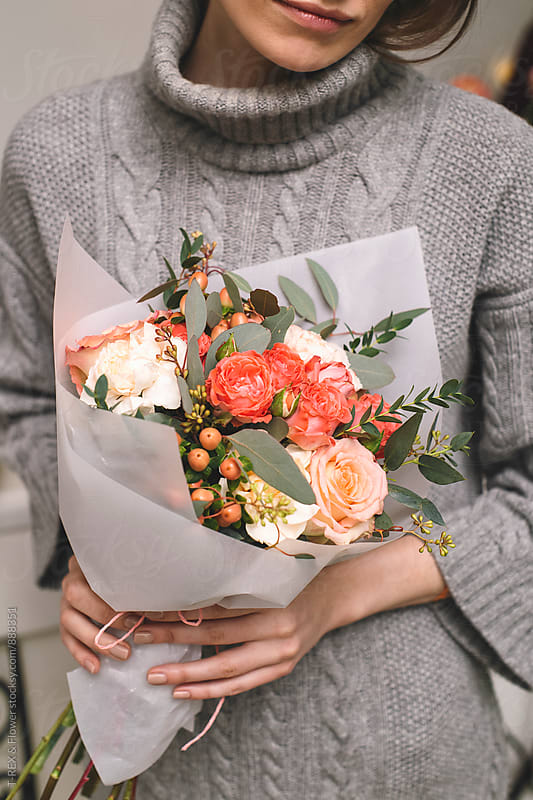 Close-up of wrapped bouquet of roses decorated with eucalyptus