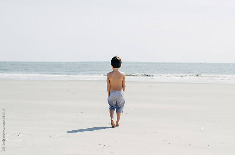 Boy Walks to the Ocean by Ali Deck for Stocksy United
