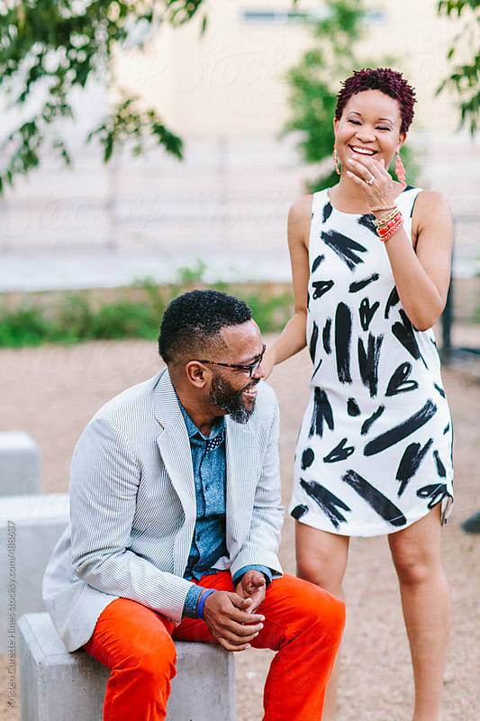 Candid portrait of a couple laughing and having a good time by Kristen Curette Hines for Stocksy United