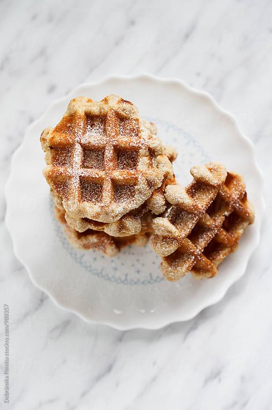Waffles with icing sugar by Dobránska Renáta for Stocksy United