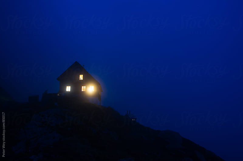 Gauli mountain hut at night by Peter Wey for Stocksy United