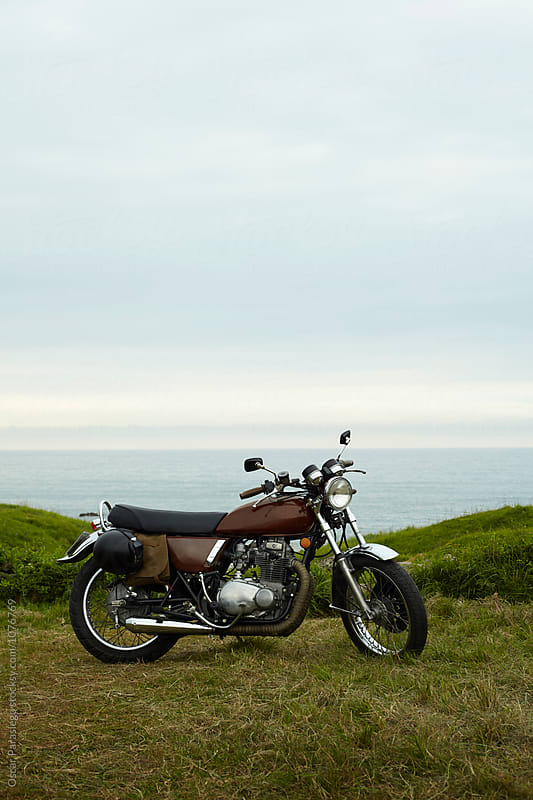 Vintage Motorcycle at the coast by Oscar Parasiego for Stocksy United