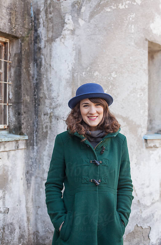 Woman in a Green Coat Smiling by Mosuno for Stocksy United