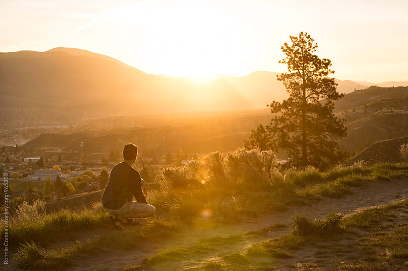 Man Experiencing The Joys Of Witnessing A Beautiful Sunrise Whilst In Nature by Ronnie Comeau for Stocksy United