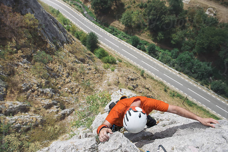 Rock climber high above the ground by RG&B Images for Stocksy United