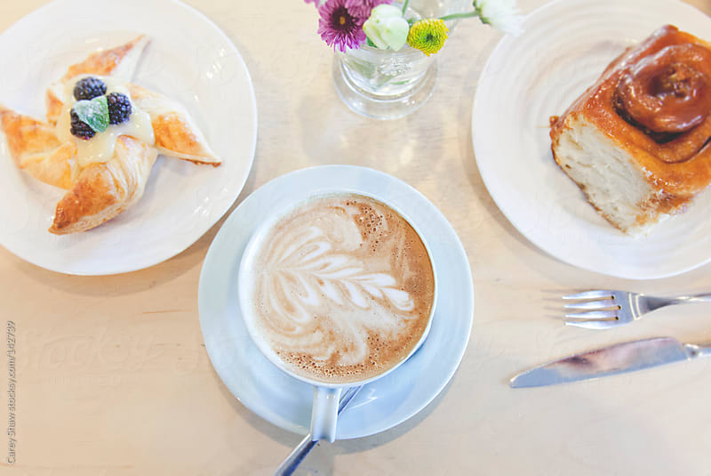 Coffee and pastry by Carey Shaw for Stocksy United