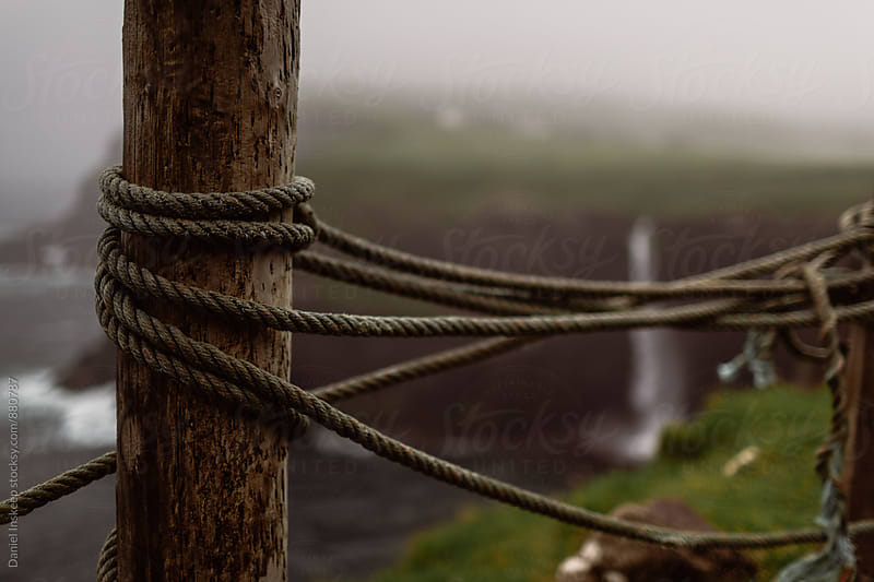 Rope Tied to a Wooden Stake with a Waterfall in the Background by Daniel Inskeep for Stocksy United