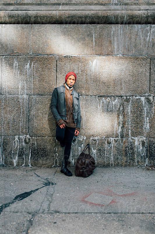 Male urban fashion portrait by Cameron Whitman for Stocksy United