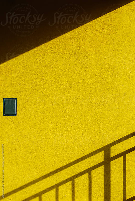 Abstract shadows on yellow wall by Aleksandar Novoselski for Stocksy United
