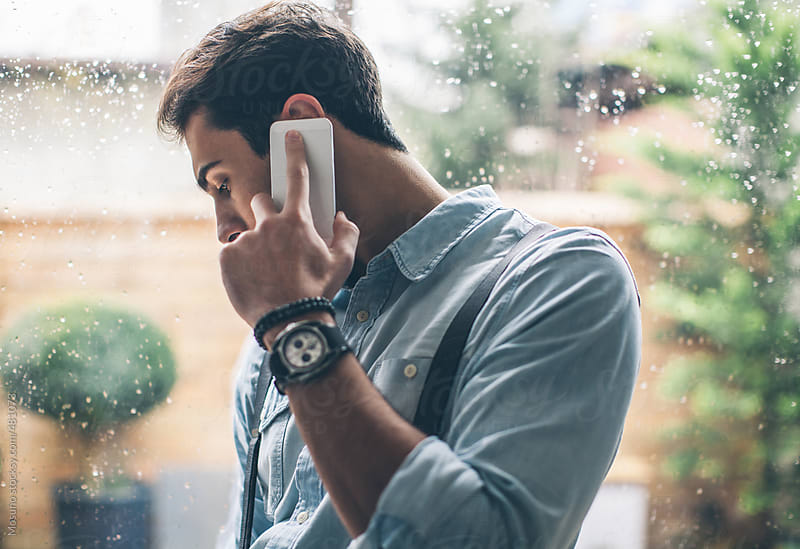Handsome Man Talking on the Phone  by Mosuno for Stocksy United