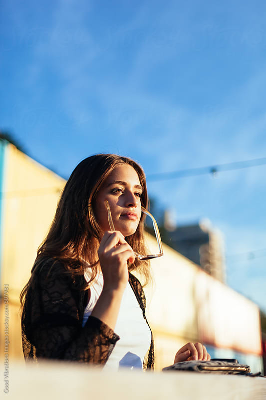 Portrait of a woman enjoying the sun by Good Vibrations Images for Stocksy United