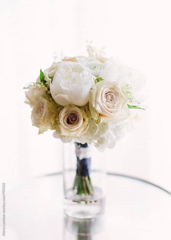 Traditional wedding bouquet by Marta Locklear for Stocksy United
