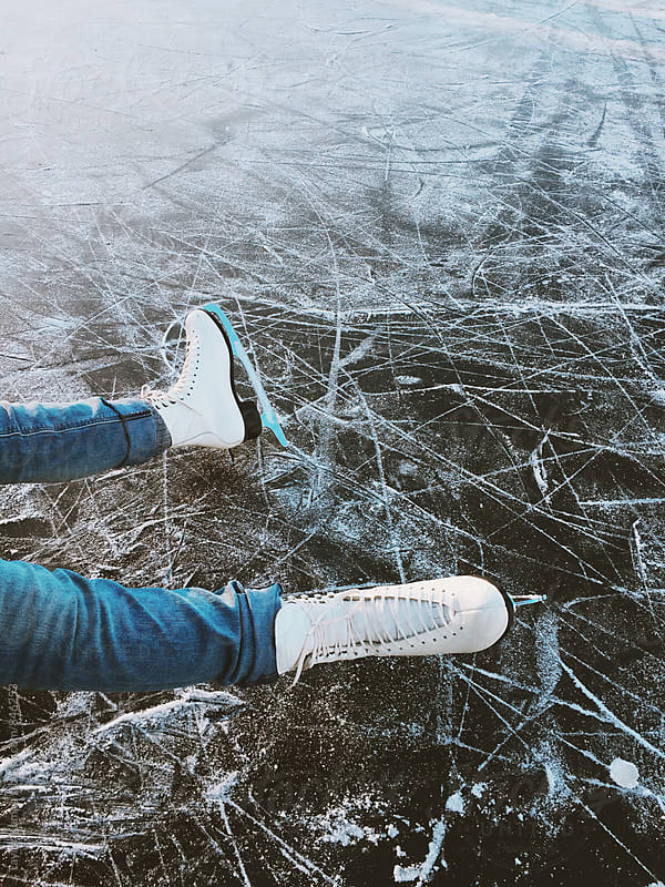 Skating on a Frozen Lake by Taylor Kampa for Stocksy United