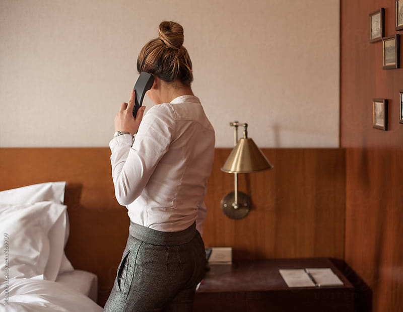 Woman Phone in a Hotel Room by Mosuno for Stocksy United