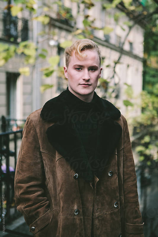 stylish blonde man wearing sheepskin coat in Paris by kkgas for Stocksy United