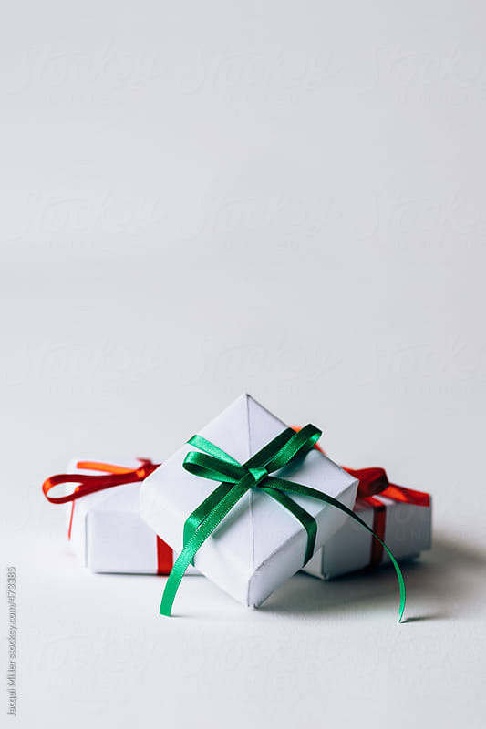 Three small gift boxes tied with ribbon - vertical with copyspace by Jacqui Miller for Stocksy United