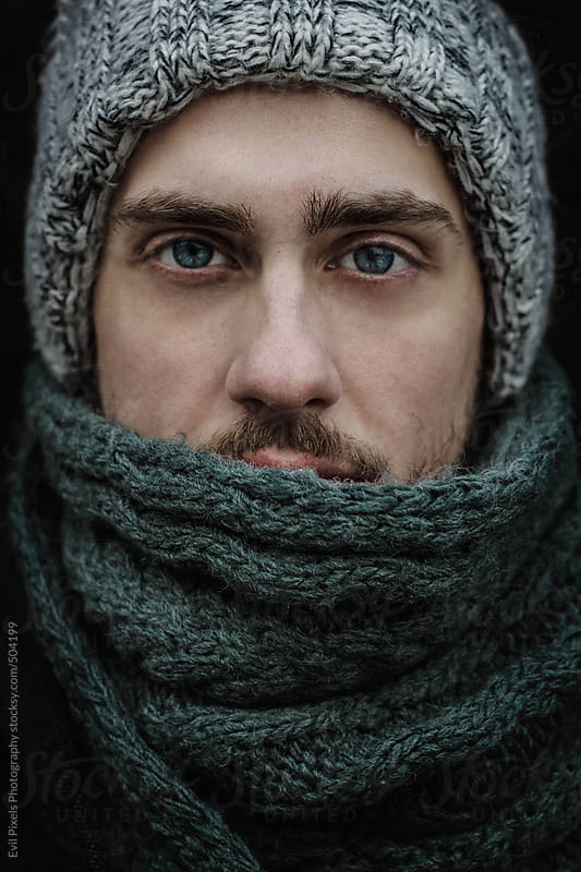 Close up of a beautiful male model in winter clothes  by Evil Pixels Photography for Stocksy United