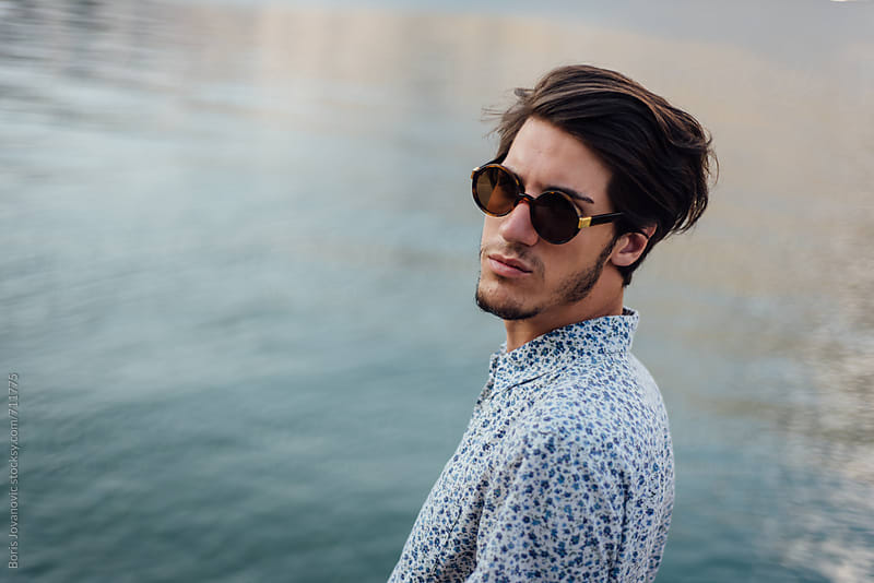 Portrait of fashionable man against the sea  by Boris Jovanovic for Stocksy United