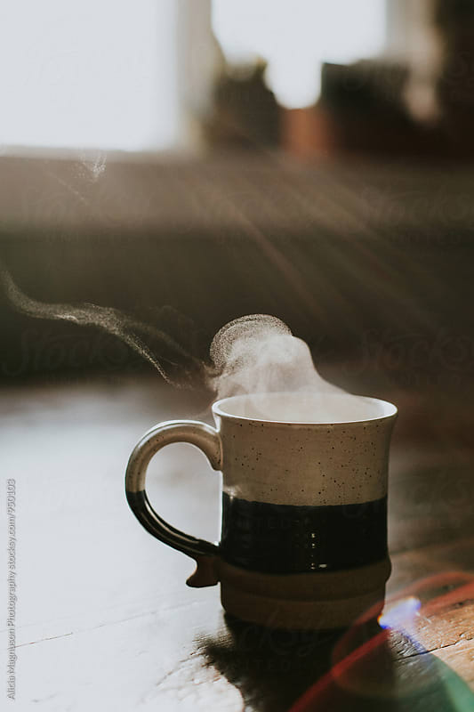 Steaming Coffee Cup on Table by Alicia Magnuson Photography for Stocksy United