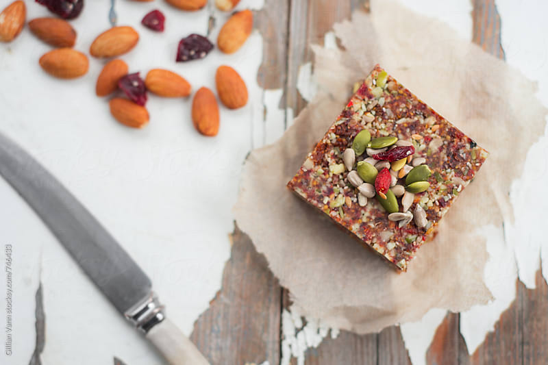 vegan raw gluten free nut and seed slice by Gillian Vann for Stocksy United