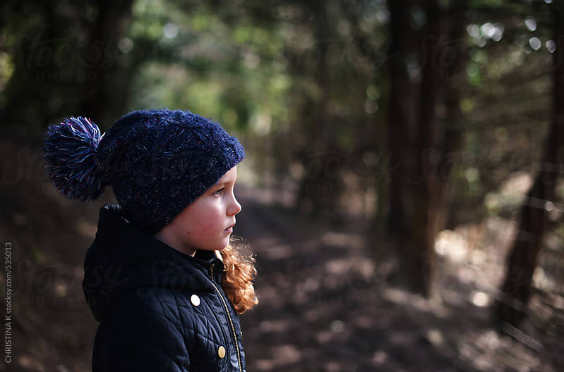 Portrait of a girl on a woodland path by CHRISTINA K for Stocksy United