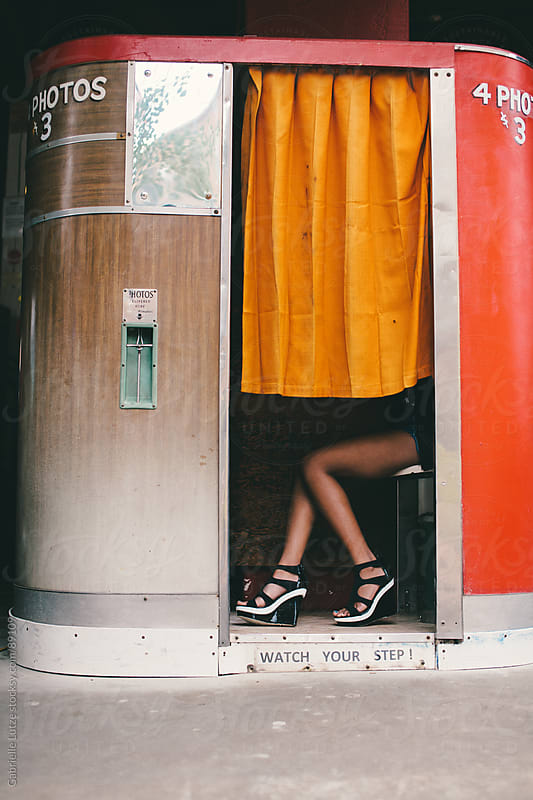 Black girl in Photo Booth just legs by Gabrielle Lutze for Stocksy United