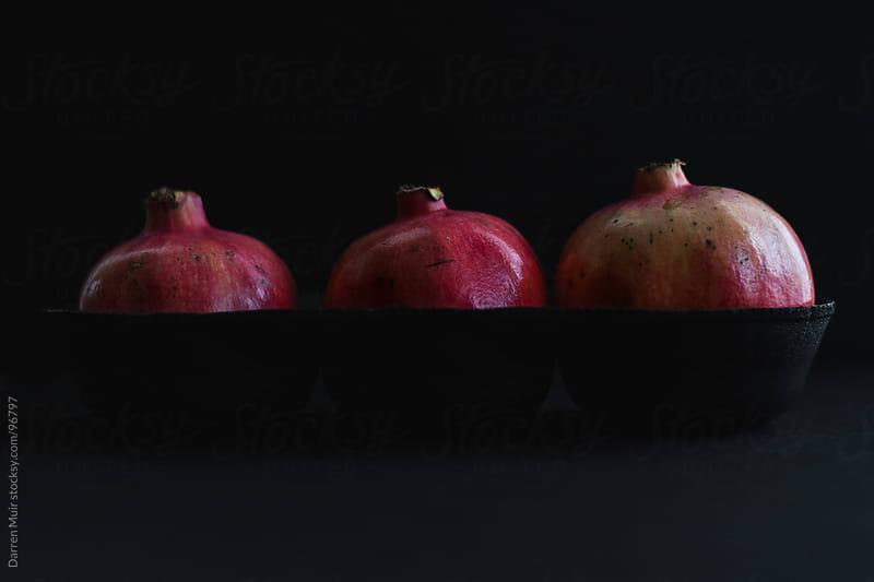 Pomegranate fruit by Darren Muir for Stocksy United
