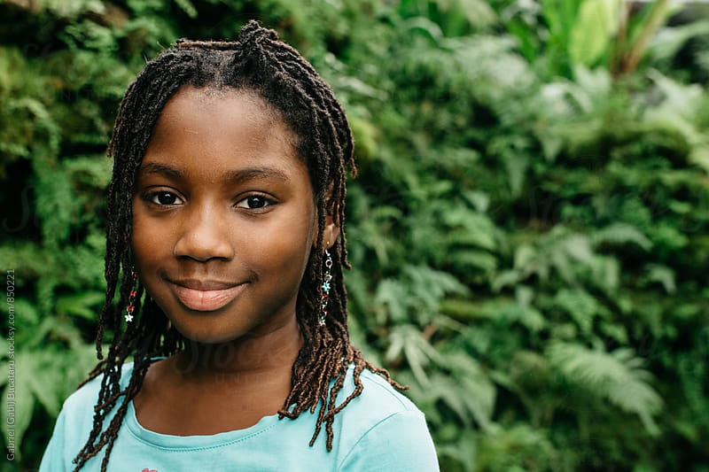 Smiling African American girl in a tropical forest by Gabriel (Gabi) Bucataru for Stocksy United