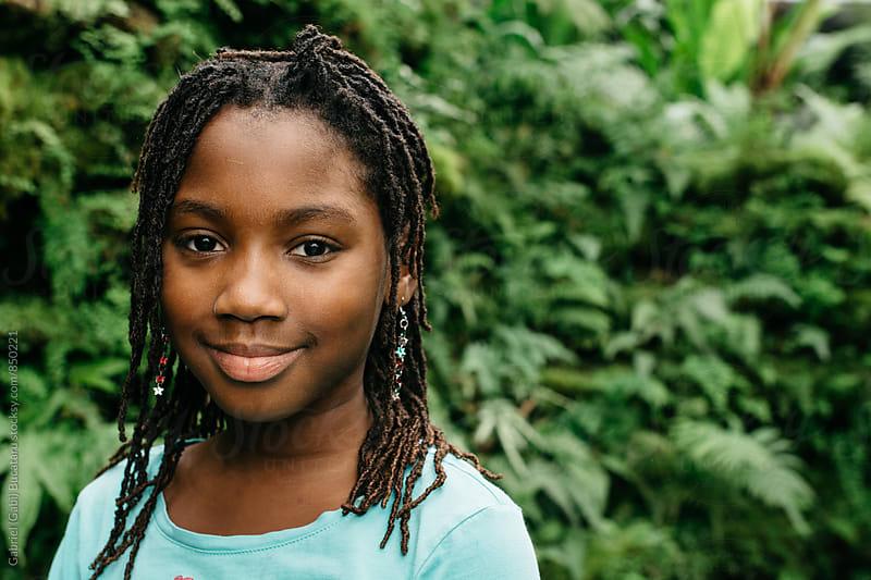Smiling African American girl in a tropical forest by Gabriel (Gabi) Bucataru for Stocksy United