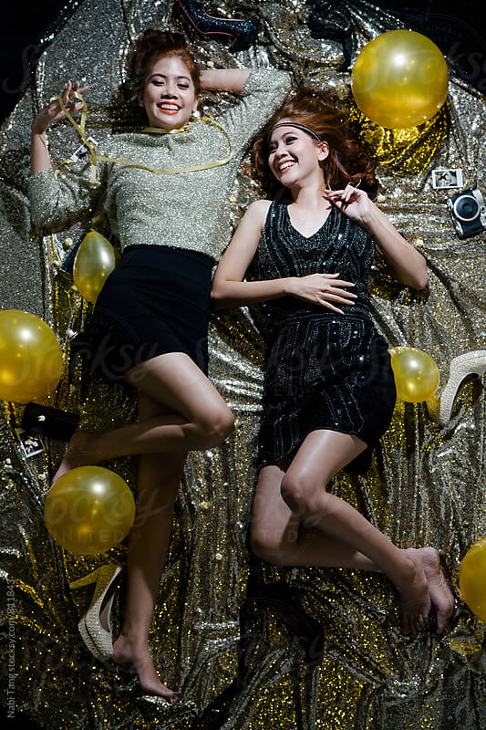 Twin sisters having fun in the party by Nabi Tang for Stocksy United