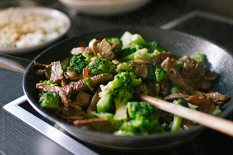 Asian beef with broccoli and mushrooms by Davide Illini for Stocksy United