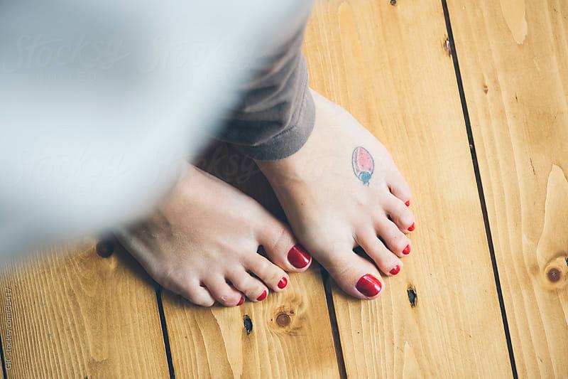 Bare feet on wooden floor by GIC for Stocksy United