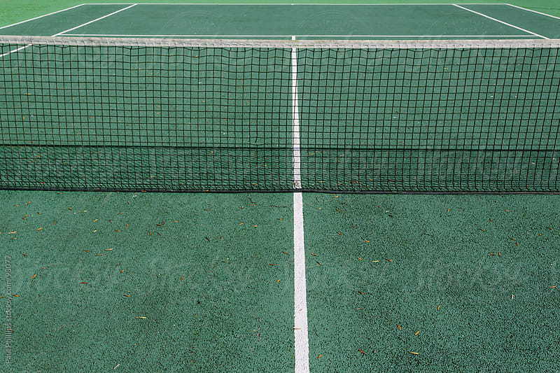 Tennis court detail with net by Paul Phillips for Stocksy United