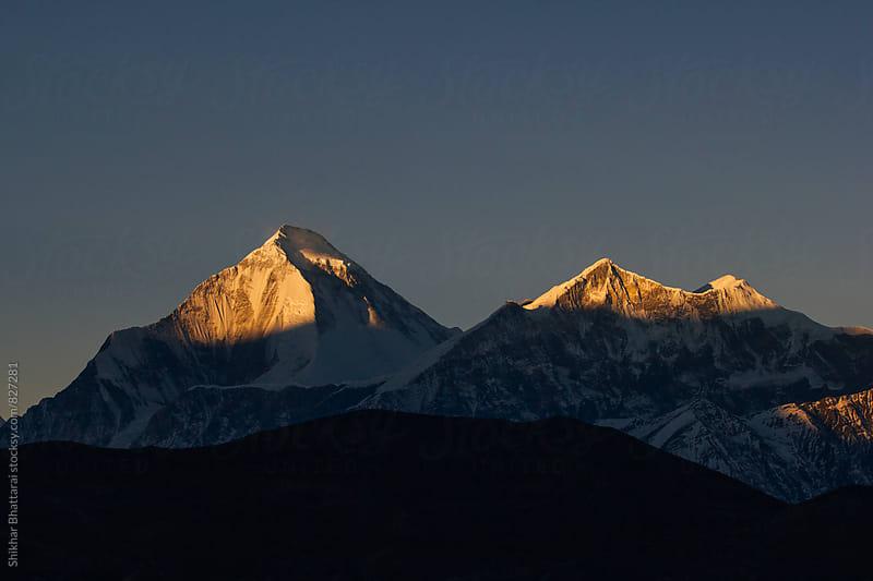 Mt. Dhaulagiri on a beautiful warm morning light. by Shikhar Bhattarai for Stocksy United