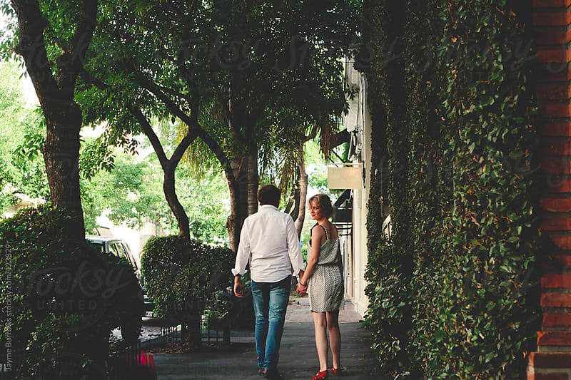 Couple Walks Together by Jayme Burrows for Stocksy United