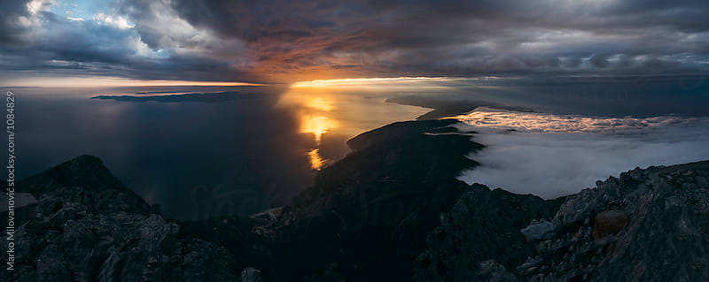Sunset on seaside from the top of the mountain by Marko Milovanović for Stocksy United