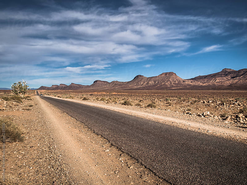 Road through Desert Landscape in Morocco by Andreas Wonisch for Stocksy United
