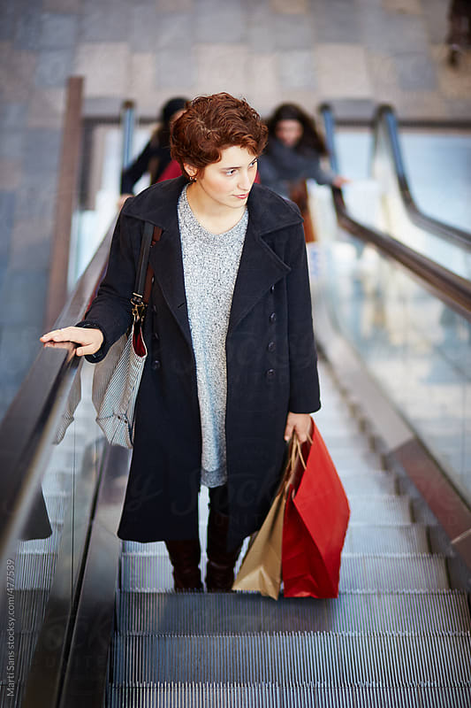 Young woman shopping by Martí Sans for Stocksy United