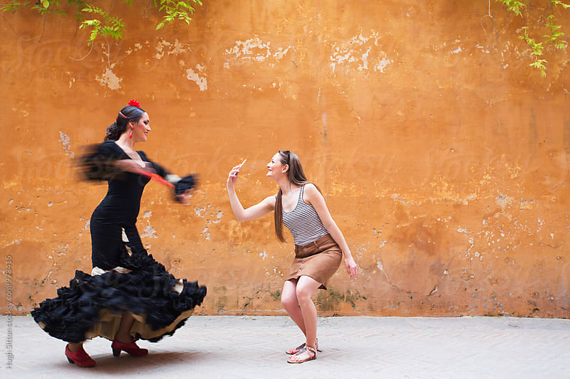 Tourist taking picture of Flamenco Dancer. Spain. by Hugh Sitton for Stocksy United