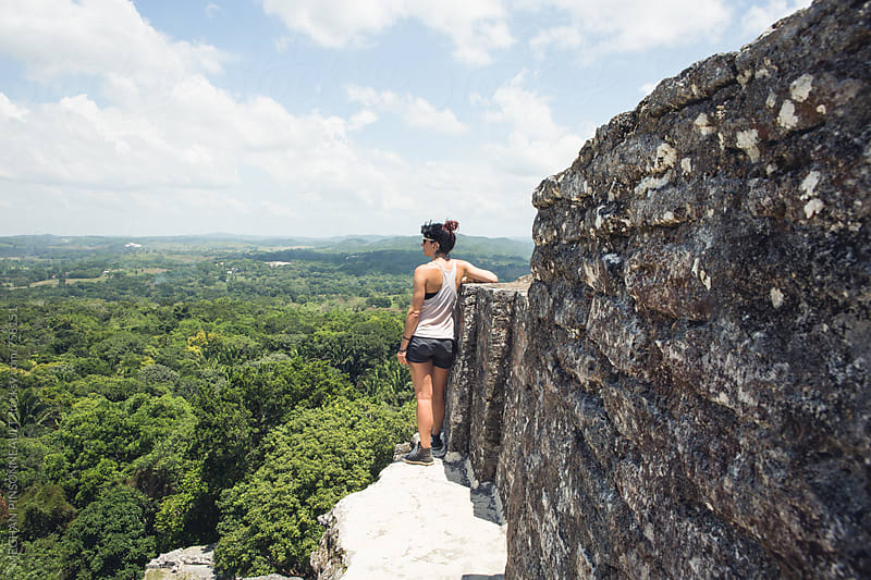 Woman Enjoying View From Atop Ancient Mayan Temple by MEGHAN PINSONNEAULT for Stocksy United