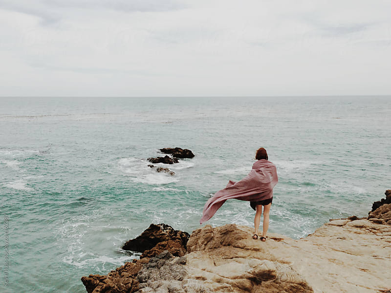 Woman Standing on Windy Coastal Cliff by Kevin Russ for Stocksy United